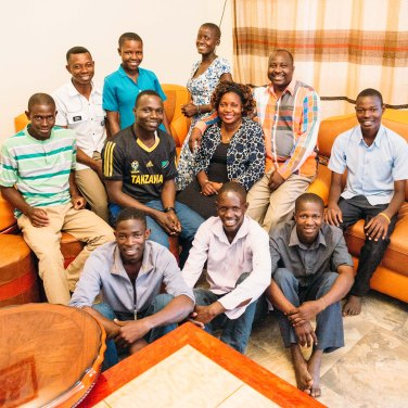 Our Uganda directors with their 9 adopted children